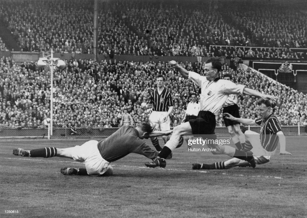 FA Cup Final, Birmingham City v Manchester City, Wembley. Manchester's goalkeeper Bert Trautmann dives at the feet of Birmingham's Murphy during the match. It was whilst making this save that Trautmann unknowingly broke his neck. MandatoryCredit: Allsport Hulton/Archive
