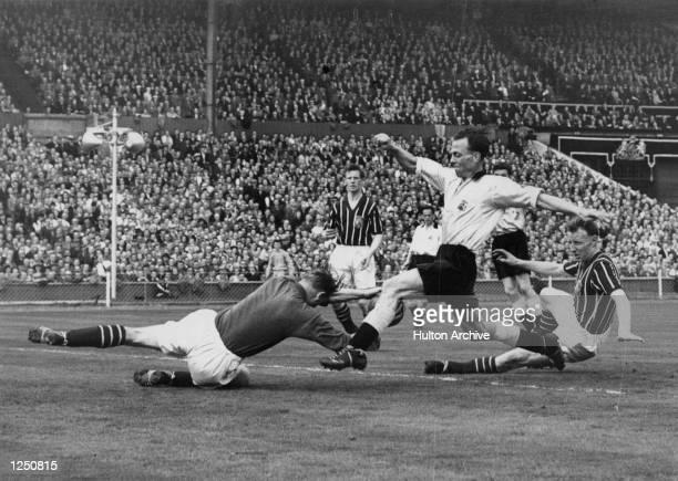 FA Cup Final Birmingham City v Manchester City Wembley Manchester's goalkeeper Bert Trautmann dives at the feet of Birmingham's Murphy during the...