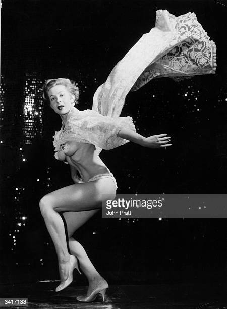 20 year old Diane D'Orsay from South Africa performs her striptease act in the Diamond Garter Revue at the Piccadilly Theatre Restaurant 'Pigalle'