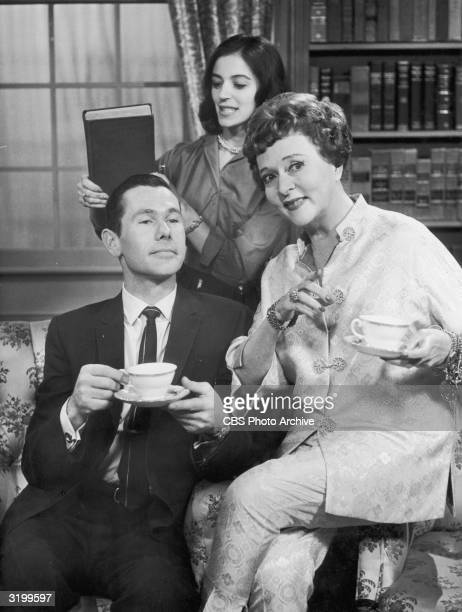 American comedian and television show host Johnny Carson has tea with actors Jessie Royce Landis and Marisa Pavan in the comedy skit 'The Girl in the...
