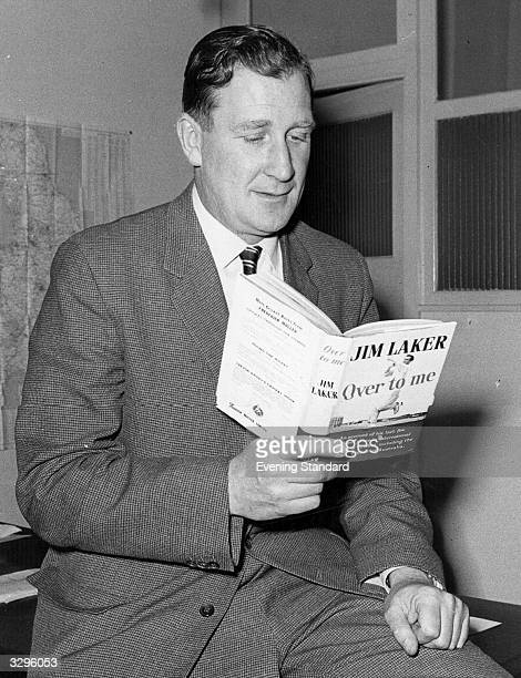 English offspin bowler Jim Laker reading his book 'Over To Me'
