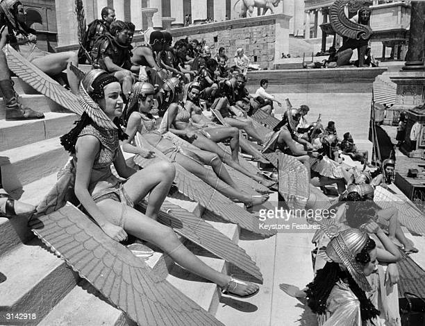 Extras in costume as handmaidens wait on the steps during the filming of the lavish 20th Century Fox production of 'Cleopatra' in Rome The film was...