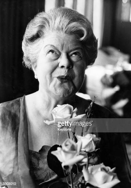 Actress Violet Carson who created the role of Ena Sharples in 'Coronation Street' appreciates the rose named after her the previous night at London's...