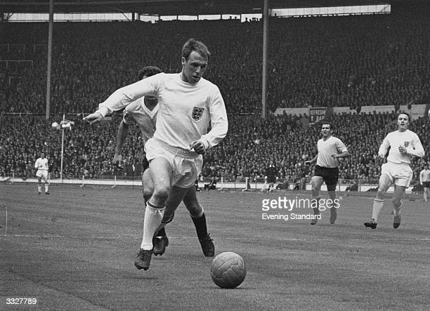 Footballer Ray Wilson a member of the World Cup winning team playing for England.