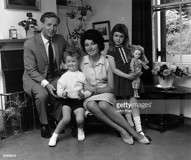 British light entertainer Nicholas Parsons and his wife Denise Bryer with their children Suzy and Justin at their Hampstead home