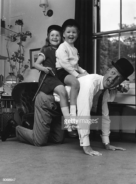 British light entertainer Nicholas Parsons with his children Suzy and Justin at their Hampstead home