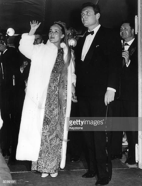 French actress Jeanne Moreau at Cannes' Twentieth International Movie Festival with Ettore Manni her costar in Tony Richardson's film 'Mademoiselle'