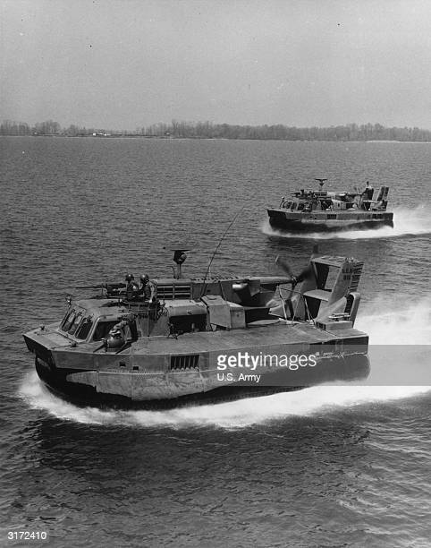 Two US Army air cushion vehicles cruise through the water during a military exercise at Aberdeen Proving Ground in Maryland during the Vietnam War...