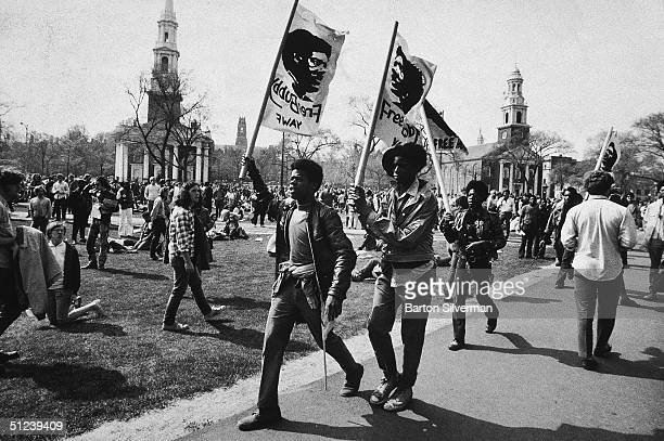 May 1970, Supporters march with flags during protest in favor of Black Panther defendants on trial for murder, New Haven, Connecticut.