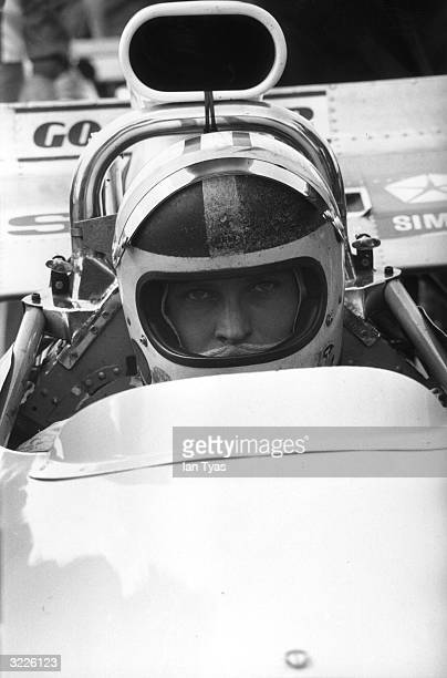 At the wheel of his MatraSimca New Zealand racing driver Chris Amon waits for the start of the 23rd GKN Daily Express International Trophy at...