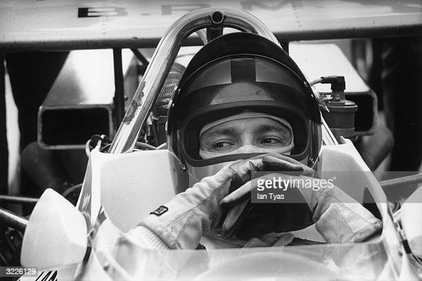 Mexican racing driver Pedro Rodriguez waits for the start of the 23rd GKN Daily Express International Trophy at Silverstone He is driving a Yardley...