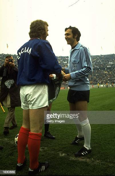 England Captain Bobby Moore chats with West German Captain Franz Beckenbauer before the European Championship qualifying match in Berlin The match...