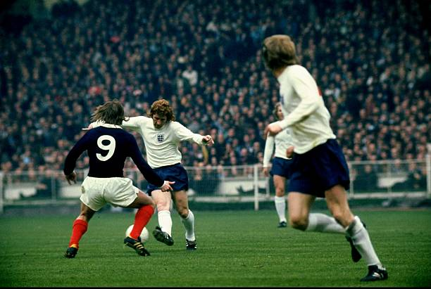 Alan Ball of England takes on Kenny Dalglish of Scotland during the international match against Scotland played at Wembley Stadium in London,...