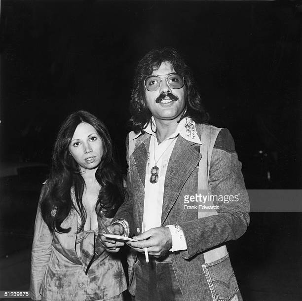 May 1974 American singer Tony Orlando smokes a cigarette while posing with his wife Elaine at a CBS party Hollywood California May 1974 He is wearing...