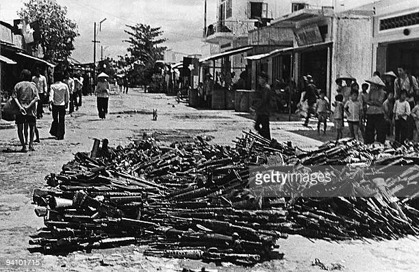 May 1975 photo shows a large pile of US-made rifles abandoned by pro-American Southern Vietnamese army soldiers collected at Nhan Nghia commune, Chau...
