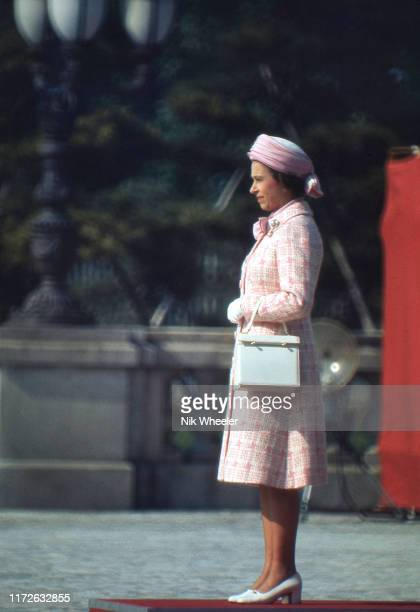 Queen Elizabeth II stands during welcome ceremony at temple in Kyoto during the royal visit to Japan in May 1975
