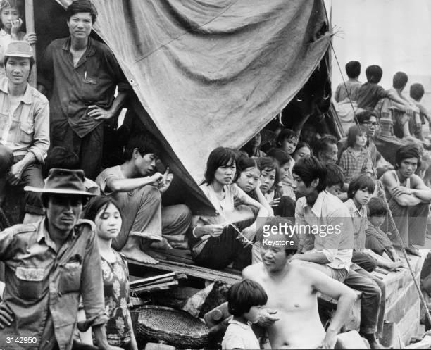 Vietnamese refugees cram the deck of a boat at the Hong Kong dockyard.