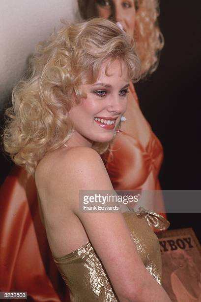 Canadian model and actor Dorothy Stratten smiles as she stands in front of a lifesize photograph of herself during a reception honoring her with the...