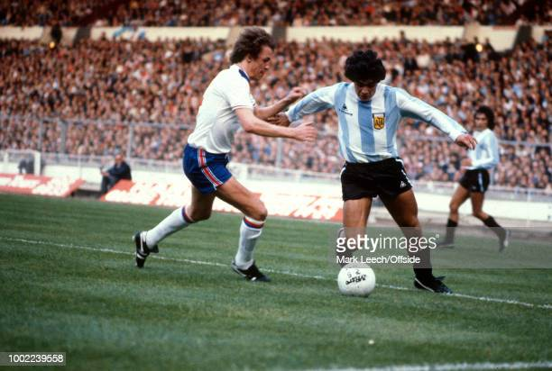 May 1980 - Wembley - England v Argentina - Phil Neal of England tries to stop Diego Maradona of Argentina -