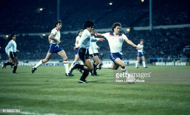 International Football Friendly Match England v Argentina Diego Maradona runs with the ball into the England penalty area where he is challenged by...