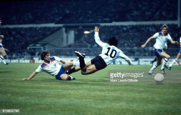International Football Friendly Match England v Argentina Diego Maradona runs with the ball into the England penalty area where he is tackled by...
