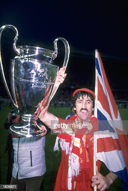David Johnson of Liverpool celebrates with the trophy after the European Cup final between Liverpool and Real Madrid in Paris Liverpool won the match...