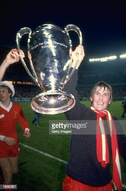 Kenny Dalglish of Liverpool holds the trophy aloft after the European Cup final against Real Madrid at Parc des Princes in Paris Liverpool won the...