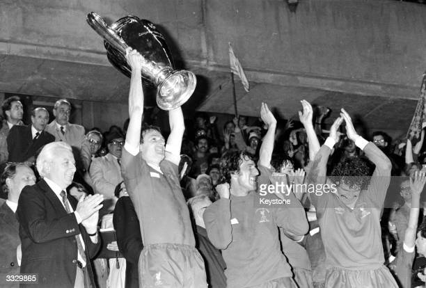 Liverpool Captain Phil Thompson lifts the European Cup high over his head after his side's 10 victory over Real Madrid in the final in Paris...