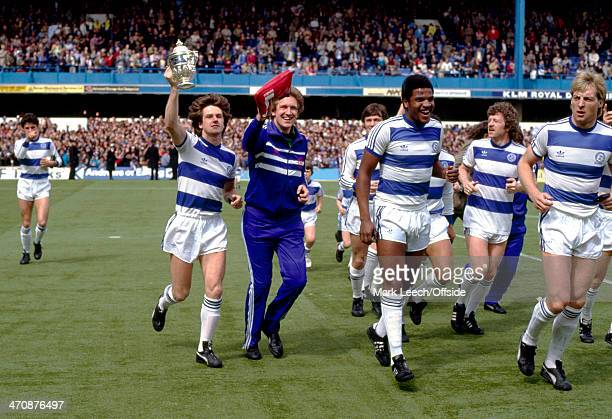 07 May 1983 Football League DivisionTwo Queens Park Rangers v Wolverhampton Wanderers Terry Fenwick of QPR holds the trophy as Rangers players...