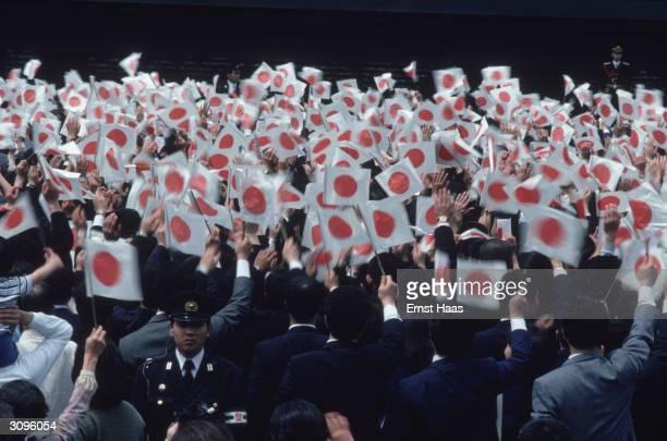 Patriots wave the Japaneskjmi ne flag at Emperor Hirohito's Birthday parade