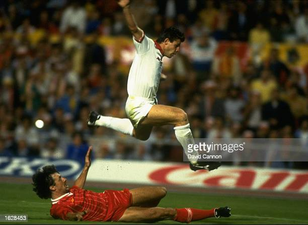 Nela of AS Roma jumps over Mark Lawrenson of Liverpool during the European Cup Final at the Olympic Stadium in Rome The match ended in a 11 draw but...