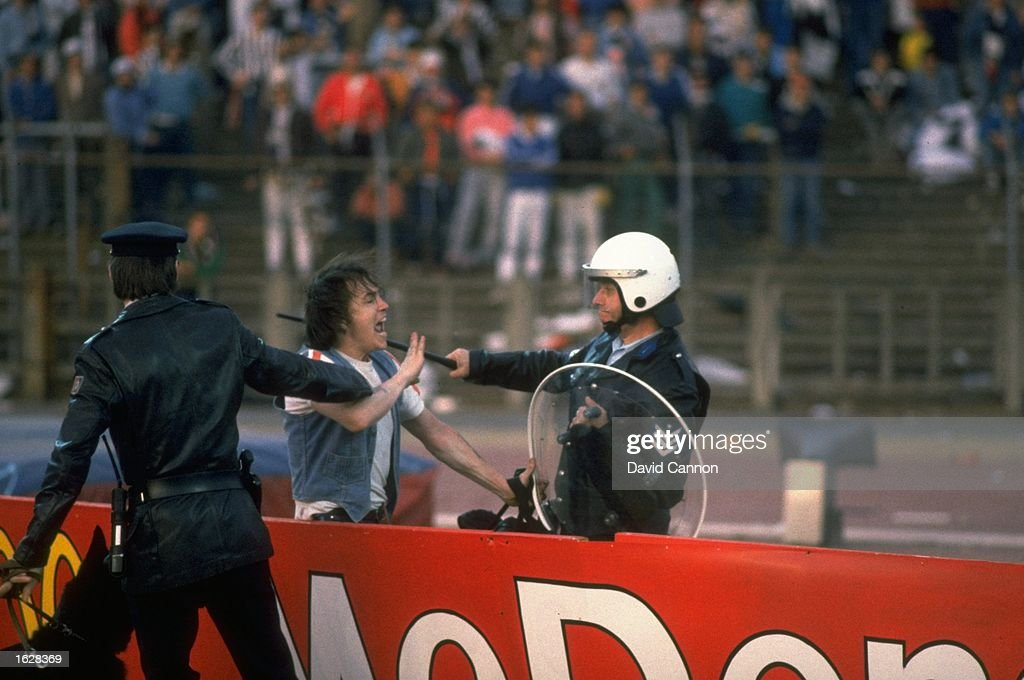 A supporter is restrained : News Photo