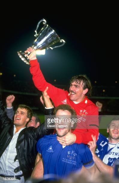 Andy Gray of Everton and Neville Southall the Everton goalkeeper celebrate amongst supporters after their victory in the European Cup Winners Cup...