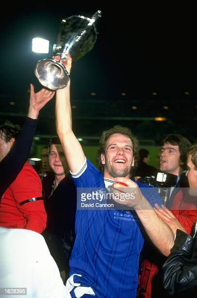 Andy Gray of Everton holds the trophy aloft as he celebrates after their victory in the European Cup Winners Cup Final against Rapid Vienna at the...
