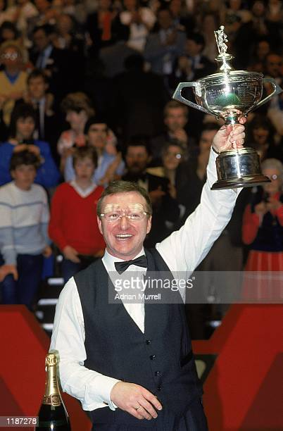 Dennis Taylor of Northern Ireland lifts the trophy after victory in the Embassy World Snooker Championship Final at the Crucible Theatre in Sheffield...