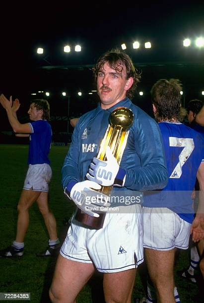 Everton goalkeeper Neville Southall holds the Canon League Division One trophy after the match against West Ham United at Goodison Park in Liverpool...