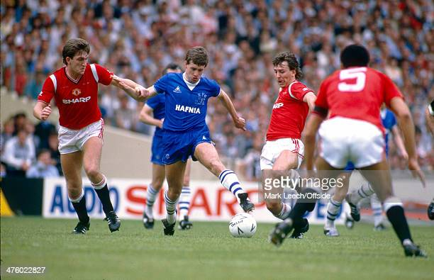 18 May 1985 FA Cup Final Manchester United v Everton Bryan Robson of United goes in for a tackle on Kevin Sheedy of Everton