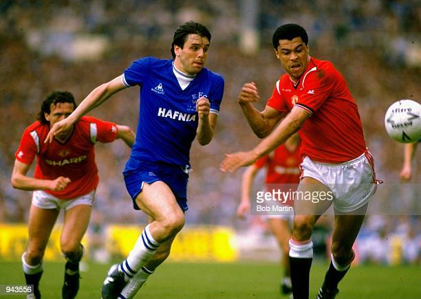 Graham Sharpe of Everton and Paul McGrath of Manchester United in action during the FA Cup Final at Wembley Stadium in London. Manchester United won...