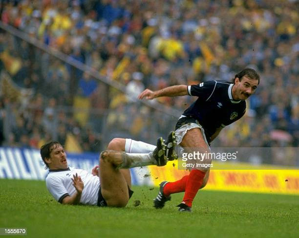 Kenny Sansom of England and Willie Miller of Scotland in action during the Rous Cup match at Hampden Park in Glasgow, Scotland. Scotland won the...