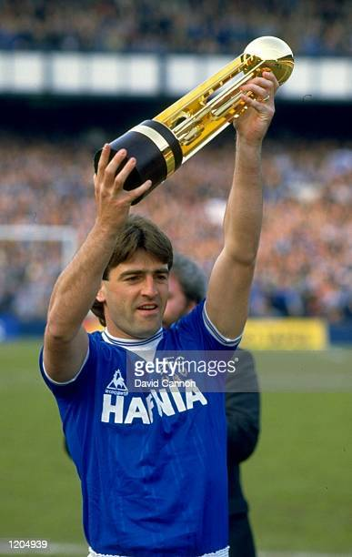 Kevin Ratcliffe of Everton holds the Canon League Division One trophy aloft after the match against West Ham played at Goodison Park in Liverpool...