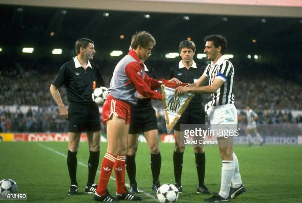 Phil Neal of Liverpool and Schirea of Juventus exchange Club pennants before the European Cup Final at the Heysel Stadium in Brussels Juventus won...