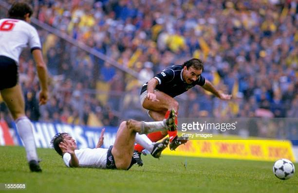 Willie Miller of Scotland is tackled by Kenny Sansom of England during the Rous Cup match at Hampden Park in Glasgow, Scotland. Scotland won the...