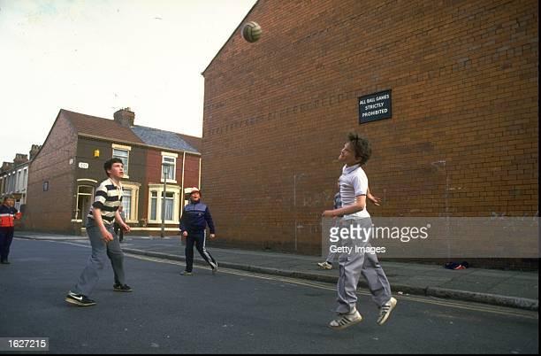 Children play street football in Liverpool England Mandatory Credit Allsport UK /Allsport