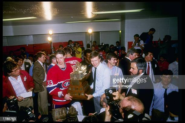 Goaltender Patrick Roy of the Montreal Canadiens holds the Conn Smythe Trophy after the Canadiens defeated the Calgary Flames to win the series 4-1...