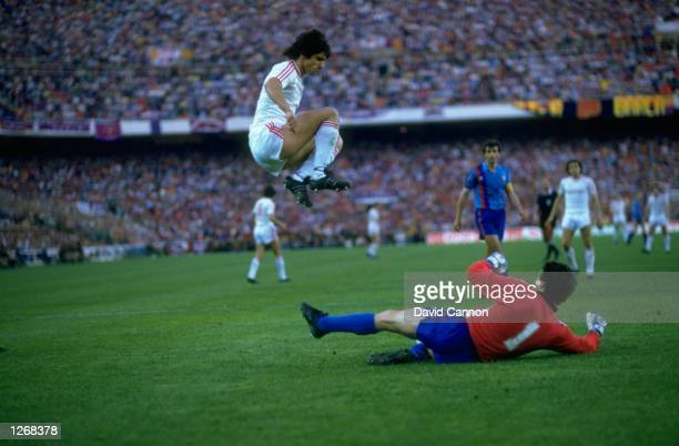 Marius Lacatus of Steaua Bucharest and Urruti of Barcelona in action during the European Cup Final match at the Sanchez Pizjuan Stadium in Seville...