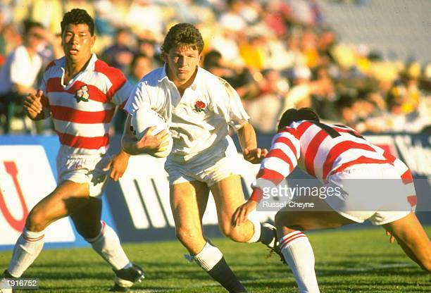 Mike Harrison of England powers his way through the opposition defence during the Rugby World Cup match between England and Japan in Sydney Australia...