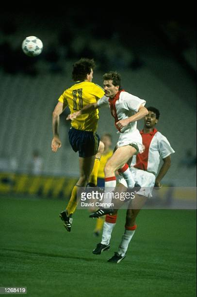 Olaf Marschal of Lokomotive Leipzig and Jan Wouters of Ajax jump for the ball during the European Cup Winners Cup Final match at the Olympiako...