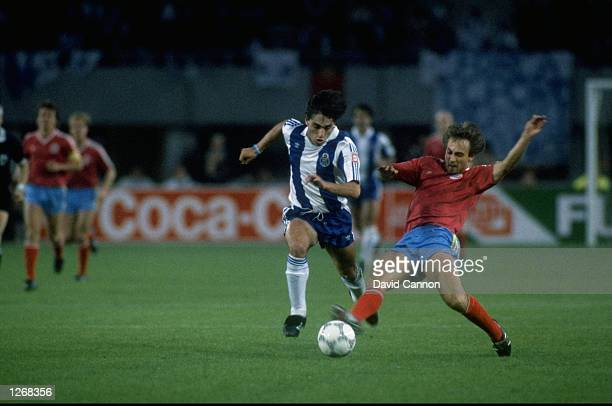 Paolo Futre of Porto is tackled by Flick of Bayern Munich during the European Cup Final match in Vienna Austria Porto won the match 21 Mandatory...