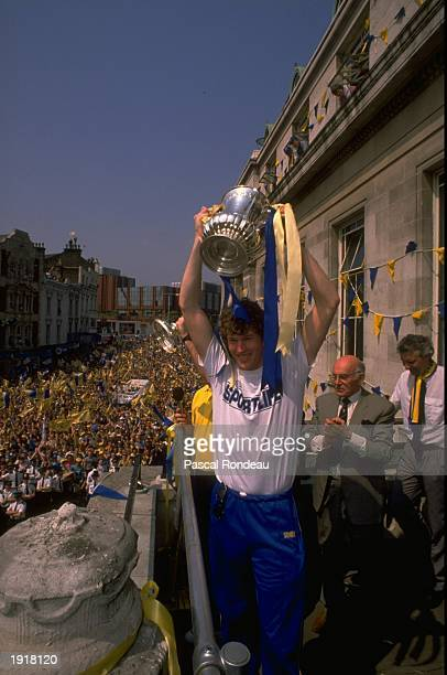 Dave Beasant of Wimbledon holds the trophy aloft during their homecoming after the FA Cup final against Liverpool at Wembley Stadium in London...