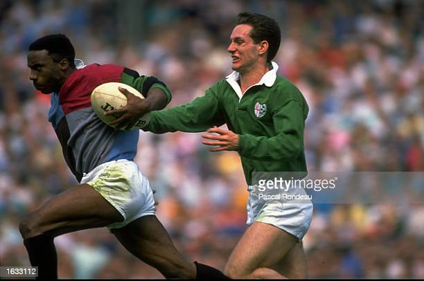 Everton Weekes of the Harlequins powers forwards with the ball during the Middlesex Sevens match against London Irish at Twickenham in London...